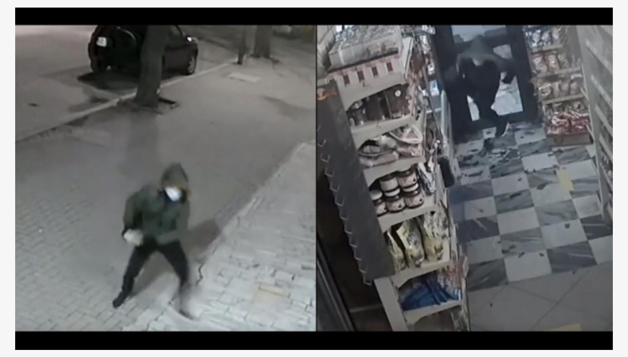 (VIDEO) Grabitësi thyen derën me gurë, rrëmben paratë nga arka e supermarketit